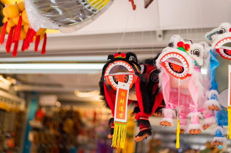 Shops sale souvenirs, gift and decoration. Lucky ornaments at street market in Chinatown, Singapore. Singapore city, Singapore - 3 March 2018: Shops sale stock image