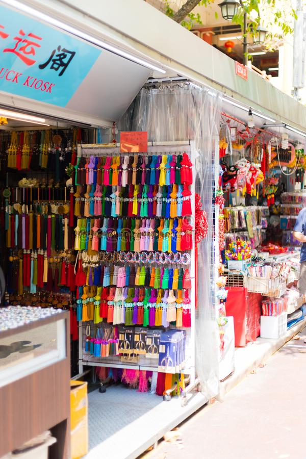 Shops sale souvenirs, gift and decoration. Lucky ornaments at street market in Chinatown, Singapore. Singapore city, Singapore - 3 March 2018: Shops sale royalty free stock photo