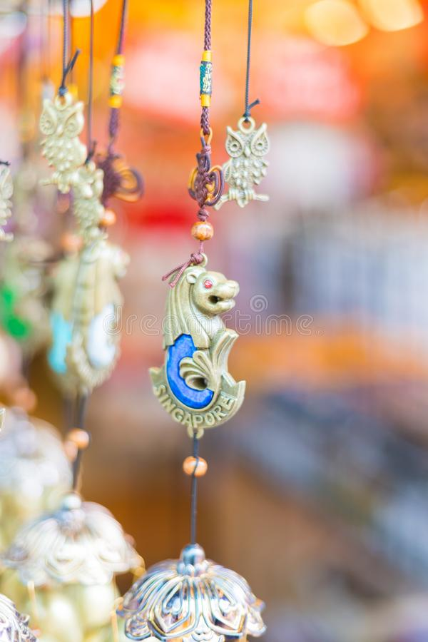Shops sale souvenirs, gift and decoration. Lucky ornaments at street market in Chinatown, Singapore. Singapore city, Singapore - 3 March 2018: Shops sale stock photo