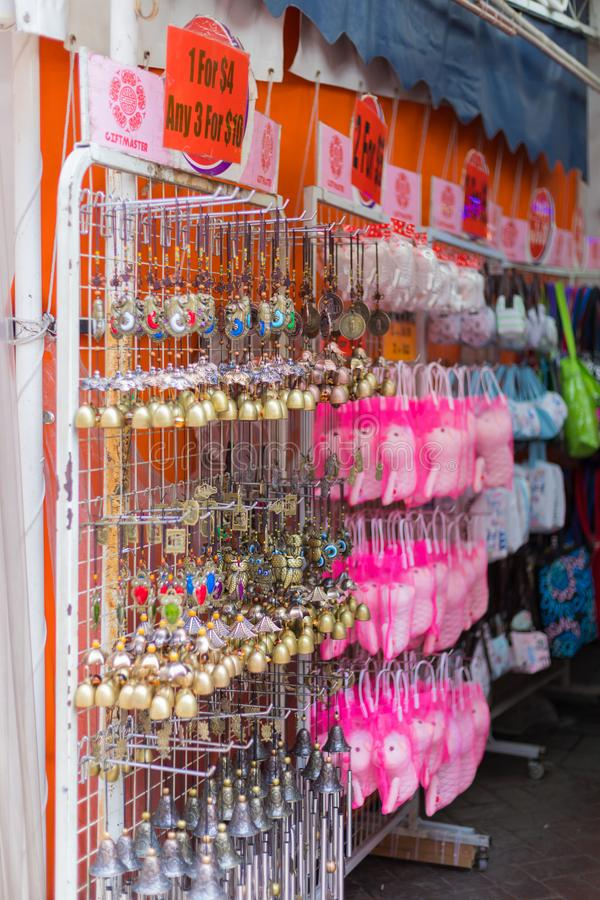 Shops sale souvenirs, gift and decoration. Lucky ornaments at street market in Chinatown, Singapore. Singapore city, Singapore - 3 March 2018: Shops sale royalty free stock photos