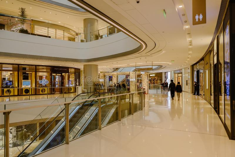 Shops selling luxuries near escalators at IFS plaza,Chengdu. China stock photography