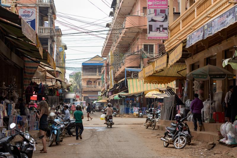 Shops in the street of Banlung town with Khmer people working during daytime stock photo