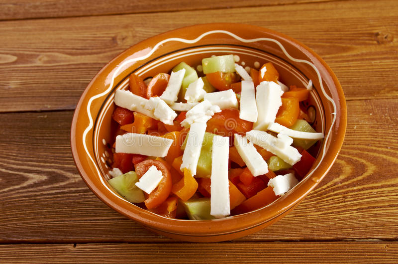 Shopska salad. Also known as Bulgarian , Macedonian,Serbian; Bosnian and Croatian salad.made from tomatoes, cucumbers, onion/scallions, raw or roasted peppers royalty free stock image
