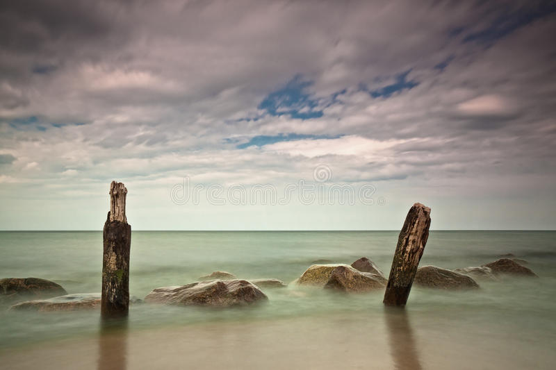 Download On shore stock image. Image of rocks, water, kuehlungsborn - 22962965