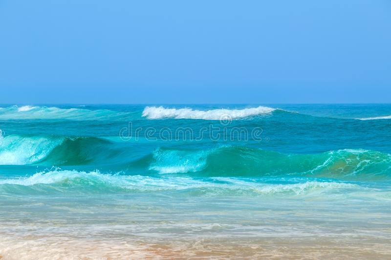 Surf on the Atlantic Ocean. Shore of the Atlantic Ocean and blue sky. Surf stock photography