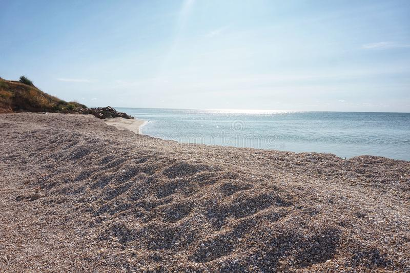 Shore of the Azov Sea in the morning sun. Clear day royalty free stock photo