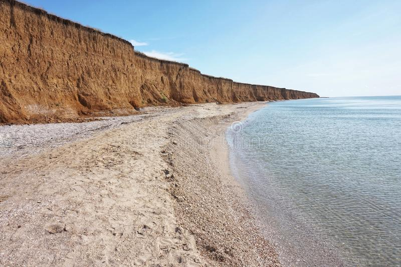Shore of the Azov Sea in the morning sun. Clear day stock images