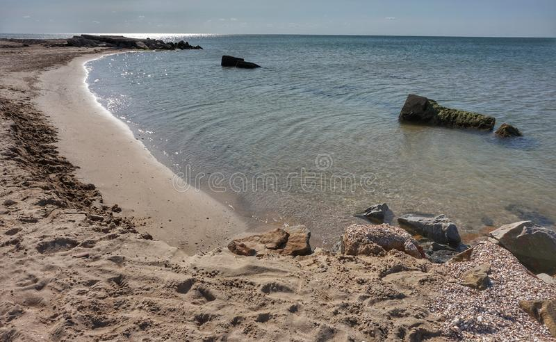 Shore of the Azov Sea in the morning sun. Clear day royalty free stock photos