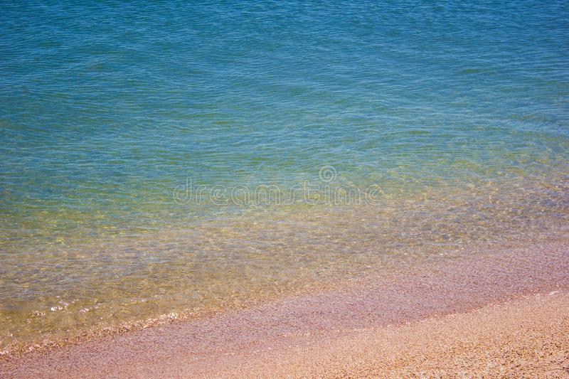 Shore beach water sea wave sand shells, background texture. Shore beach water sea wave sand shells, vacation background texture stock photography
