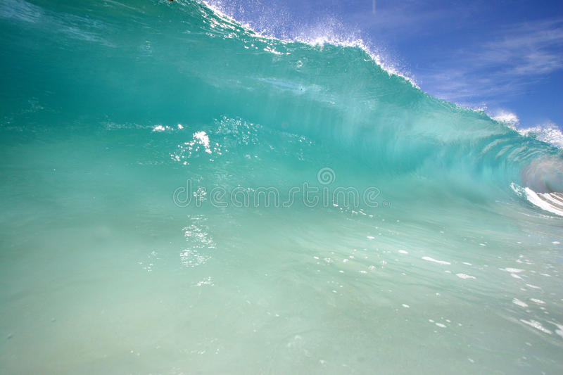 Shore breaking wave stock images