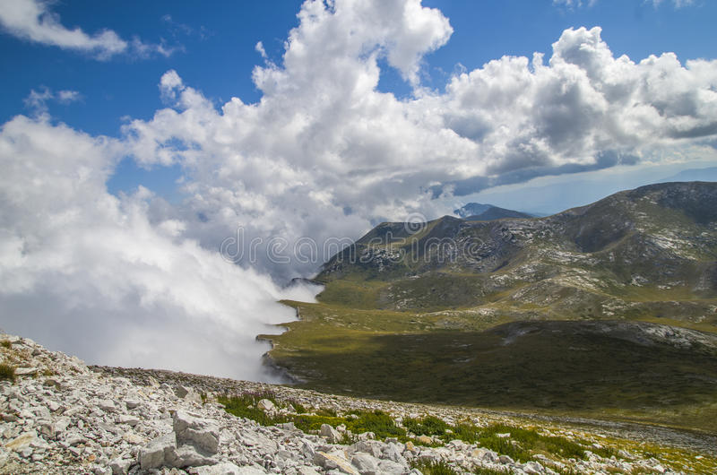 Shore with clouds in the mountain stock photo