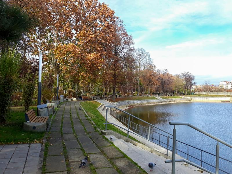 The shore of the lake in Arad city - Romania. In a sunny autumn morning royalty free stock photography