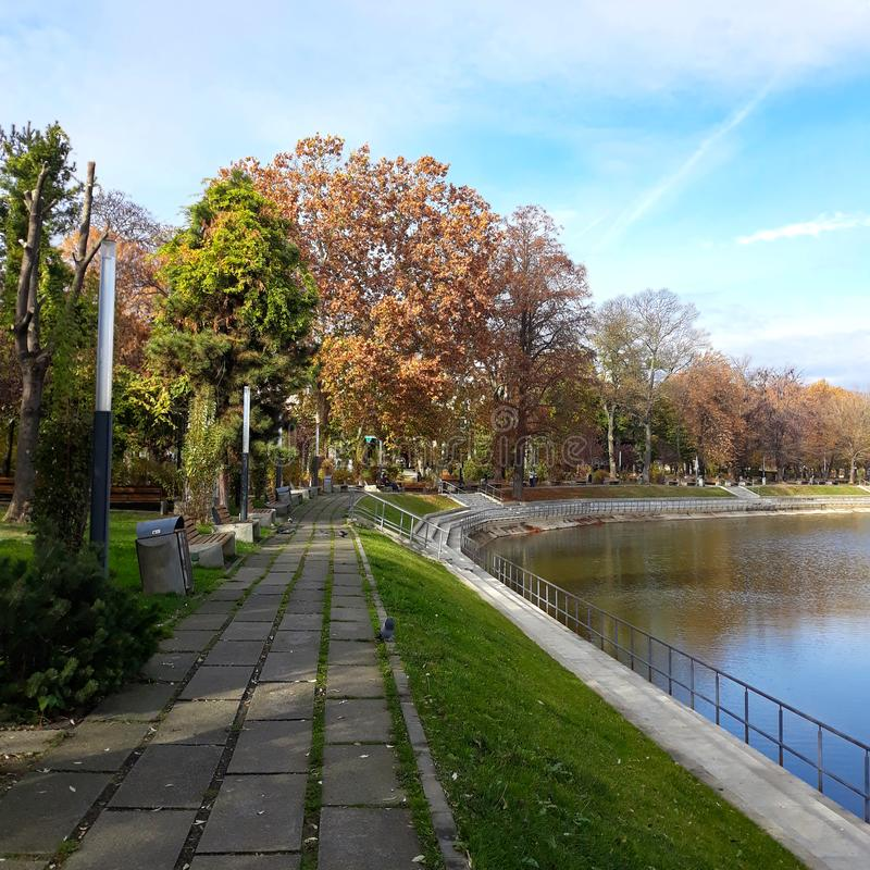 The shore of the lake in Arad city - Romania. In a sunny autumn morning stock photography