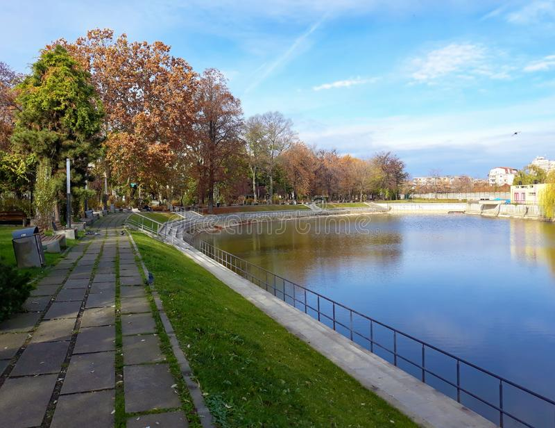 The shore of the lake in Arad city - Romania. In a sunny autumn morning stock photo