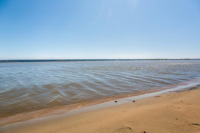 The shore of the lake, summer, beach royalty free stock images
