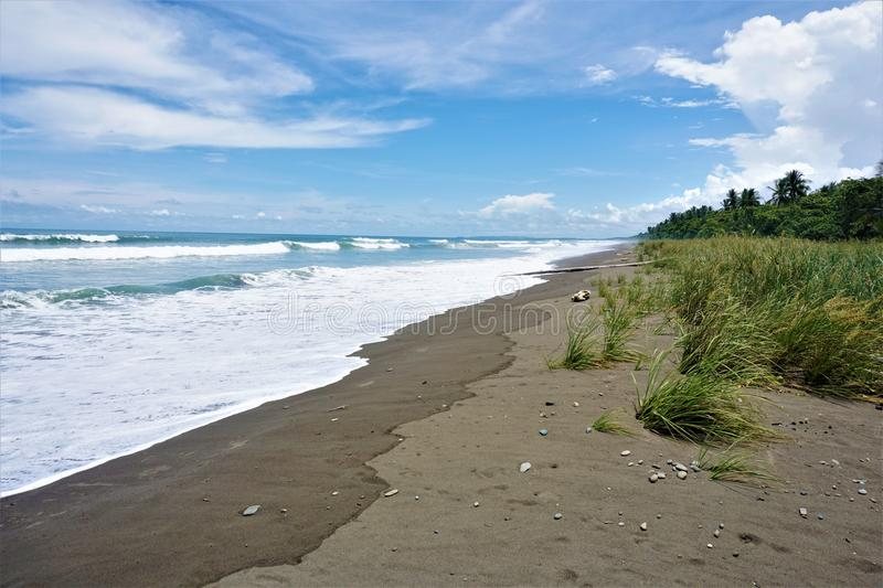 Shore at Playa Dominical in Costa Rica. The shore at Playa Dominical in Costa Rica stock photography