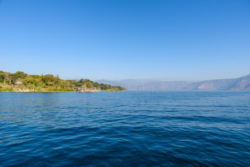 Shore of San Lucas Toliman - village at lake Atitlan, Department of Solola in Guatemala stock photography