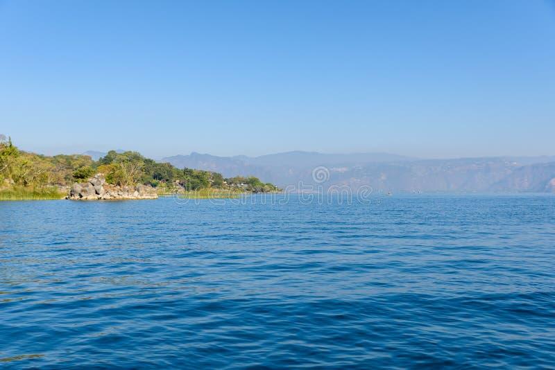 Shore of San Lucas Toliman - village at lake Atitlan, Department of Solola in Guatemala royalty free stock photos