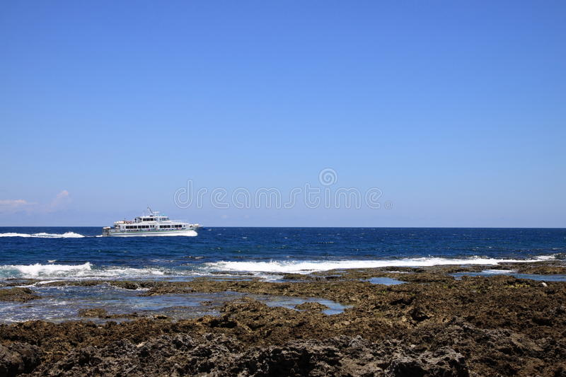 Shore and ship. Take the photo at kenting taiwan southest point, in June2009 royalty free stock photography