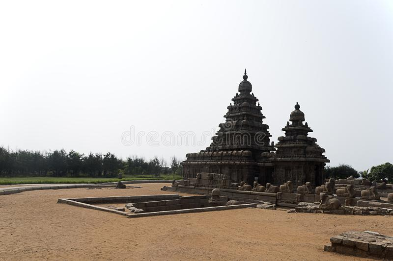 Shore temple at Mahabalipuram. He Shore Temple built in 700–728 AD is so named because it overlooks the shore of the Bay of Bengal. It is a structural royalty free stock photography