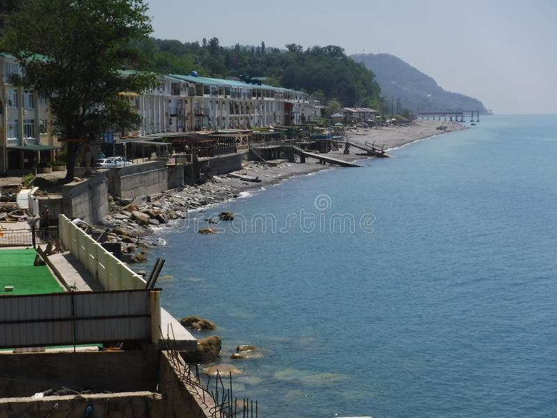 The shore and various buildings in the village of Volkonskaya on the Black Sea coast, the Greater Sochi region. stock image