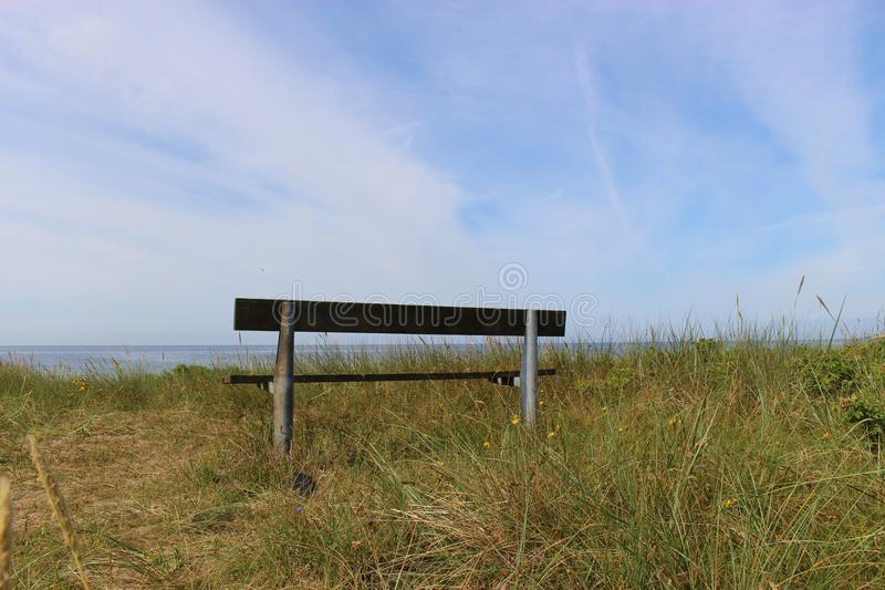 "On the shore of Ystad, South Sweden, Scandinavia, Europe. Bench in front of the Baltic sea. Ystad is film location for the crime series ""Wallander royalty free stock image"