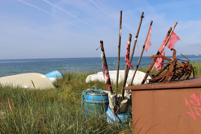 On the shore of Ystad, South Sweden, Scandinavia, Europe. Boats and fisher equipment like harpoons in front of the Baltic Sea. Ystad is film location for the royalty free stock photography