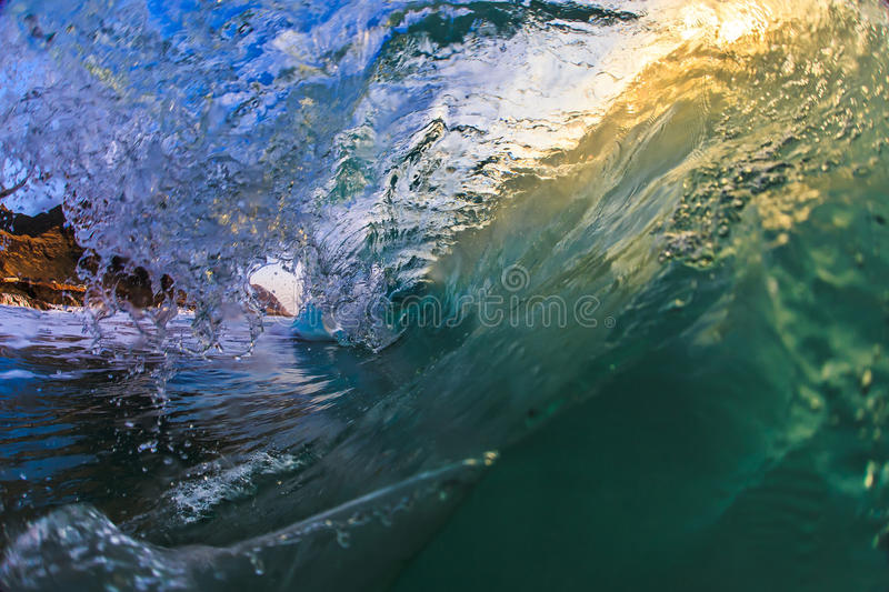 Shorebreak Bright Wave Rip Curl Barrel. Beautiful Ocean Background Big Shorebreak Wave for Surfing. Hawaiian swell for sport activity. Power and Energy Of Nature royalty free stock photo