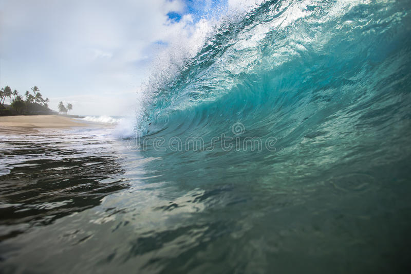 Shorebreak Wave Rip Curl Barrel. Beautiful Ocean Background Big Shorebreak Wave for Surfing. Hawaiian swell for sport activity. Power and Energy Of Nature stock photo