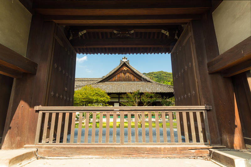 Shoren-In Front Main Gate Entrance Temple Day. A large main gate front entrance frames the centered exterior of ancient Shoren-In Temple on a sunny day in Kyoto stock photography