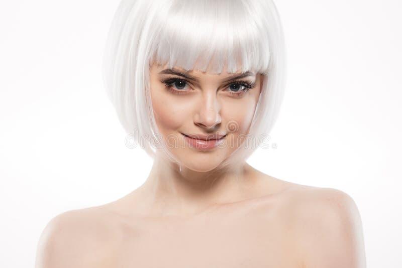 Short blonde hair woman bob platinum hairstyle. Studio shot royalty free stock photo