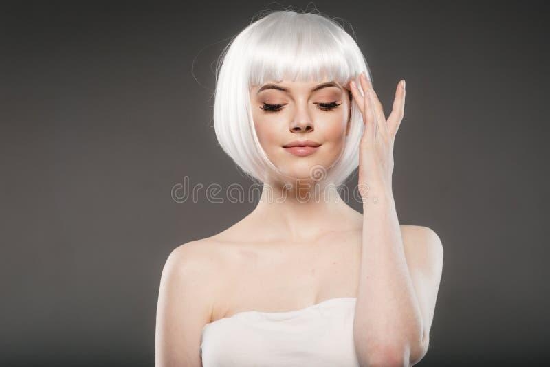 Short blonde hair woman bob platinum hairstyle. Studio shot stock photo