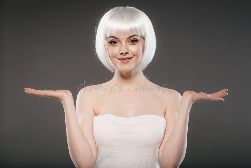 Short blonde hair woman bob platinum hairstyle. Studio shot stock photography