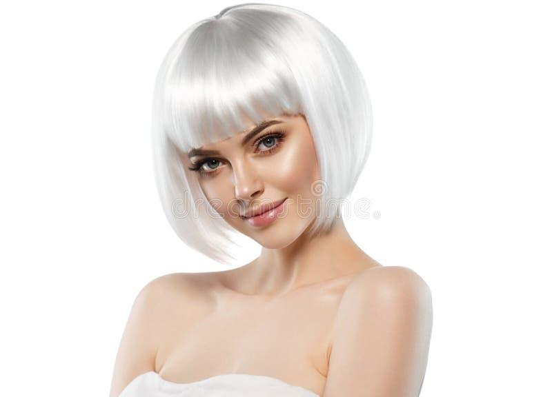 Short blonde hair woman bob platinum hairstyle. Studio shot royalty free stock image