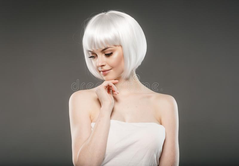 Short blonde hair woman bob platinum hairstyle. Studio shot royalty free stock photography