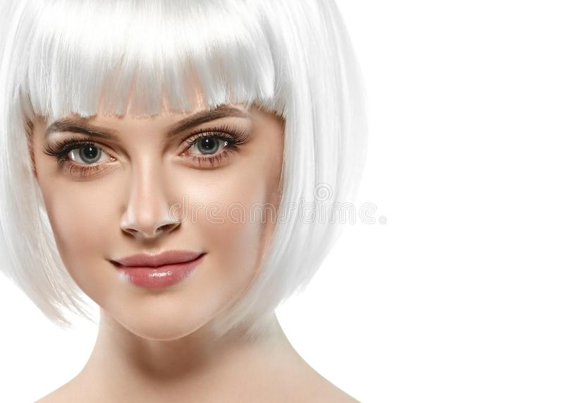 Short blonde hair woman bob platinum hairstyle. Studio shot stock photos