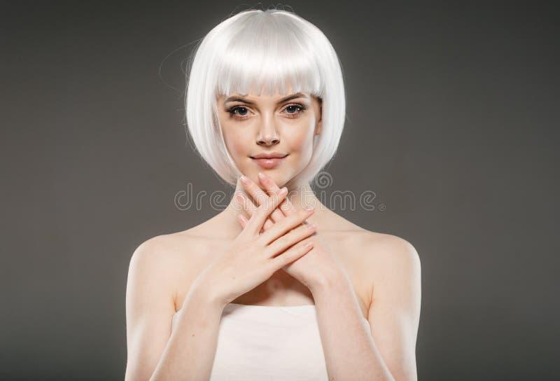 Short blonde hair woman bob platinum hairstyle. Studio shot stock images