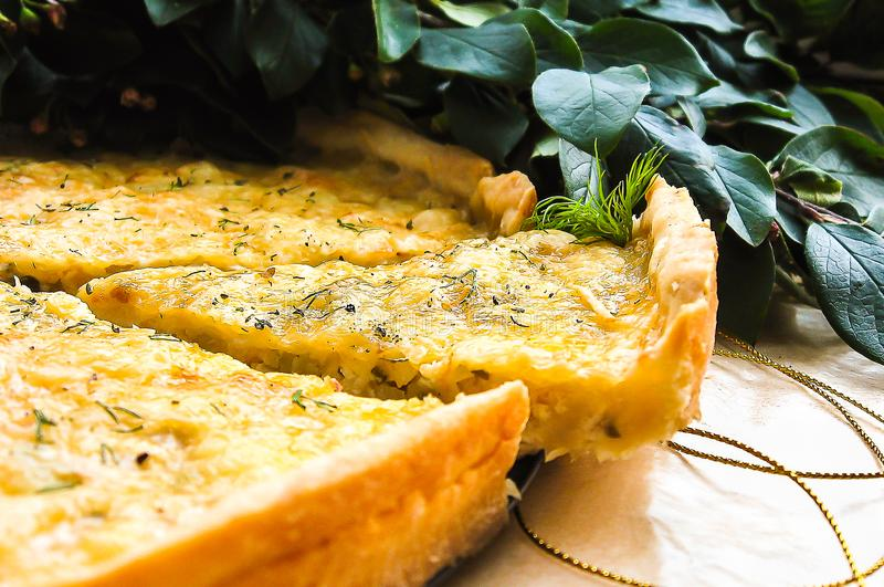 Short crust pastry savory pie or tart with white cabbage, chicken meat, apples and parmesan cheese sprinkled with dried provence h royalty free stock photo