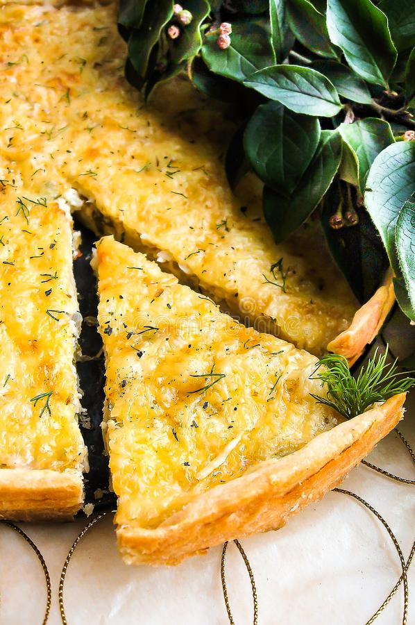 Short crust pastry savory pie or tart with white cabbage, chicken meat, apples and parmesan cheese sprinkled with dried provence h stock photos