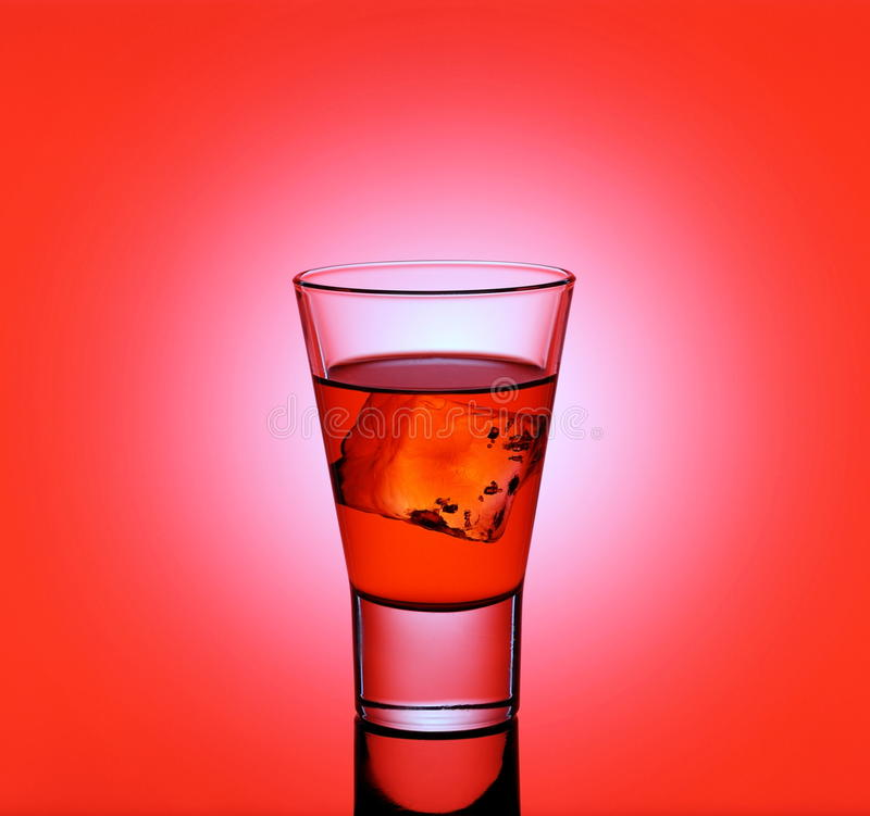Download Short Drink Glass With Red Liquid And Ice Cubes Stock Image - Image of cool, cafe: 48253903
