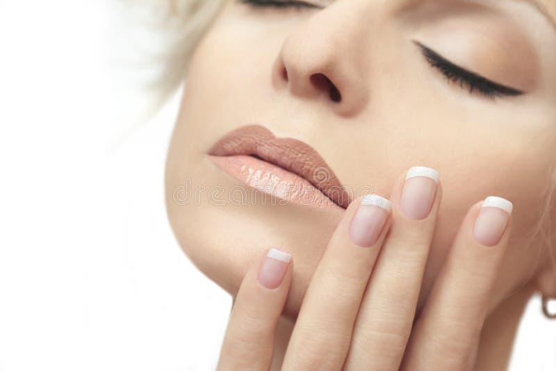 Short French manicure. stock photo