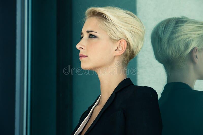 Short hair blonde profile stock photography