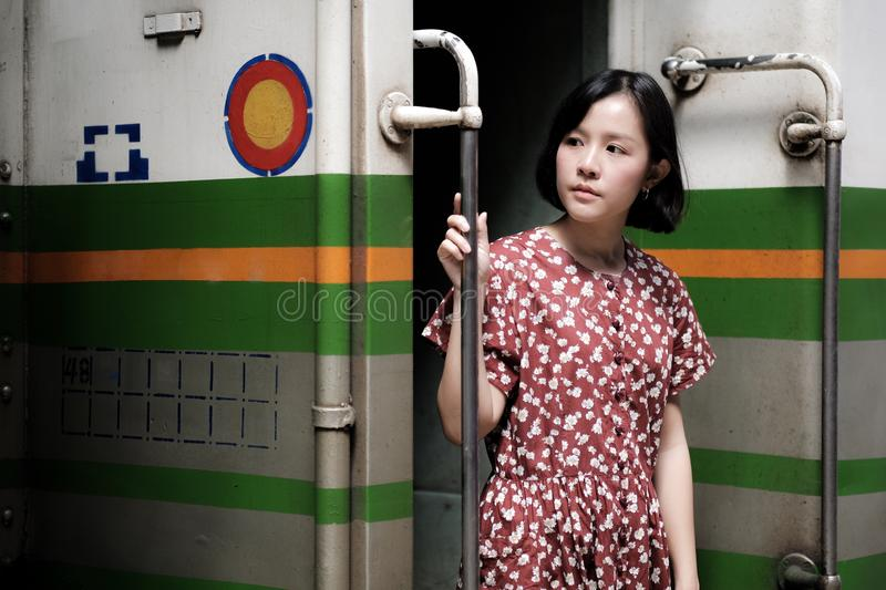 Beautiful girl traveling by train stock image