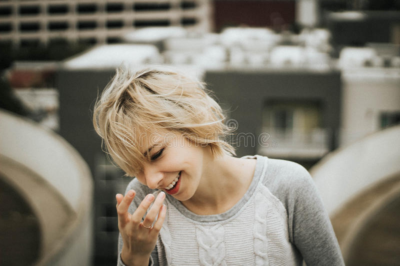 Short haired girl laughing stock images