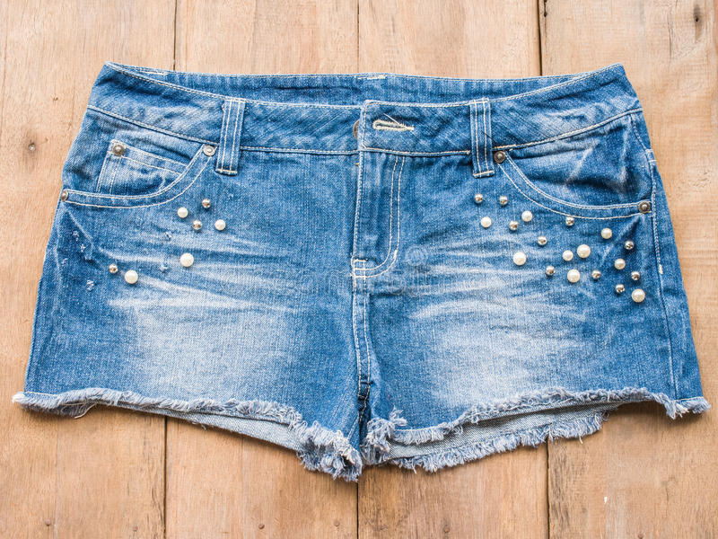 Short jean on wood background royalty free stock photos