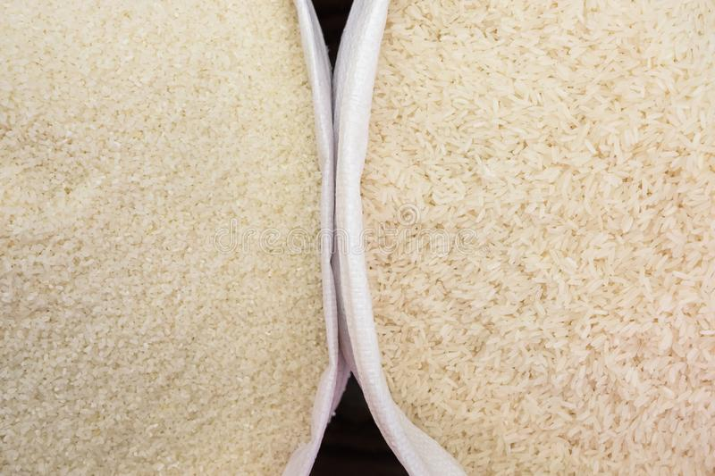 Short and long grain rice top view background stock photo