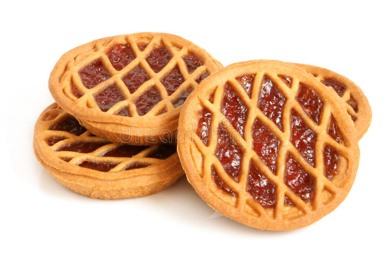 Short pies with cherry jam royalty free stock image