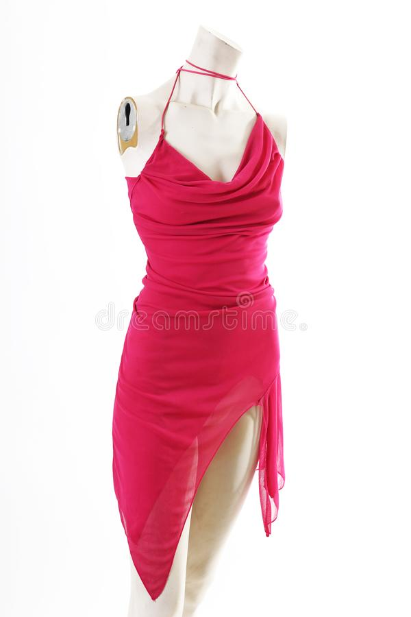 Short pink mini dress on mannequin full body shop display. Woman fashion styles, clothes on white studio background. royalty free stock photo