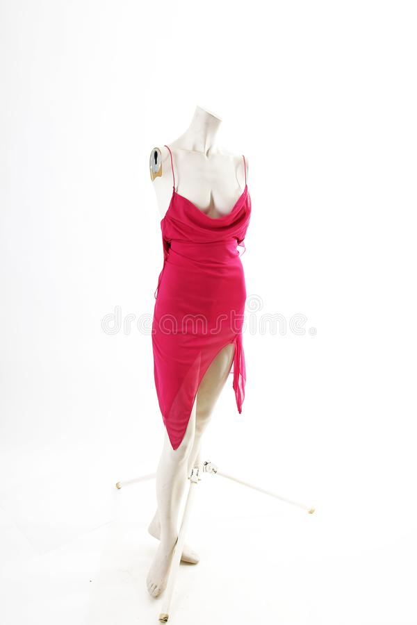 Short pink mini dress on mannequin full body shop display. Woman fashion styles, clothes on white studio background. royalty free stock photos