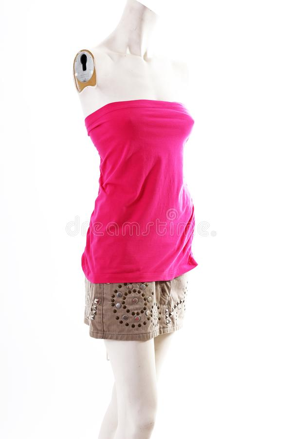 Short pink mini dress on mannequin full body shop display. Woman fashion styles, clothes on white studio background. stock images